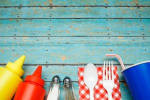 Picnic table with condiments and utensils